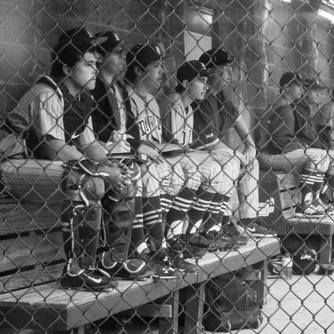 boy in dugout with dan